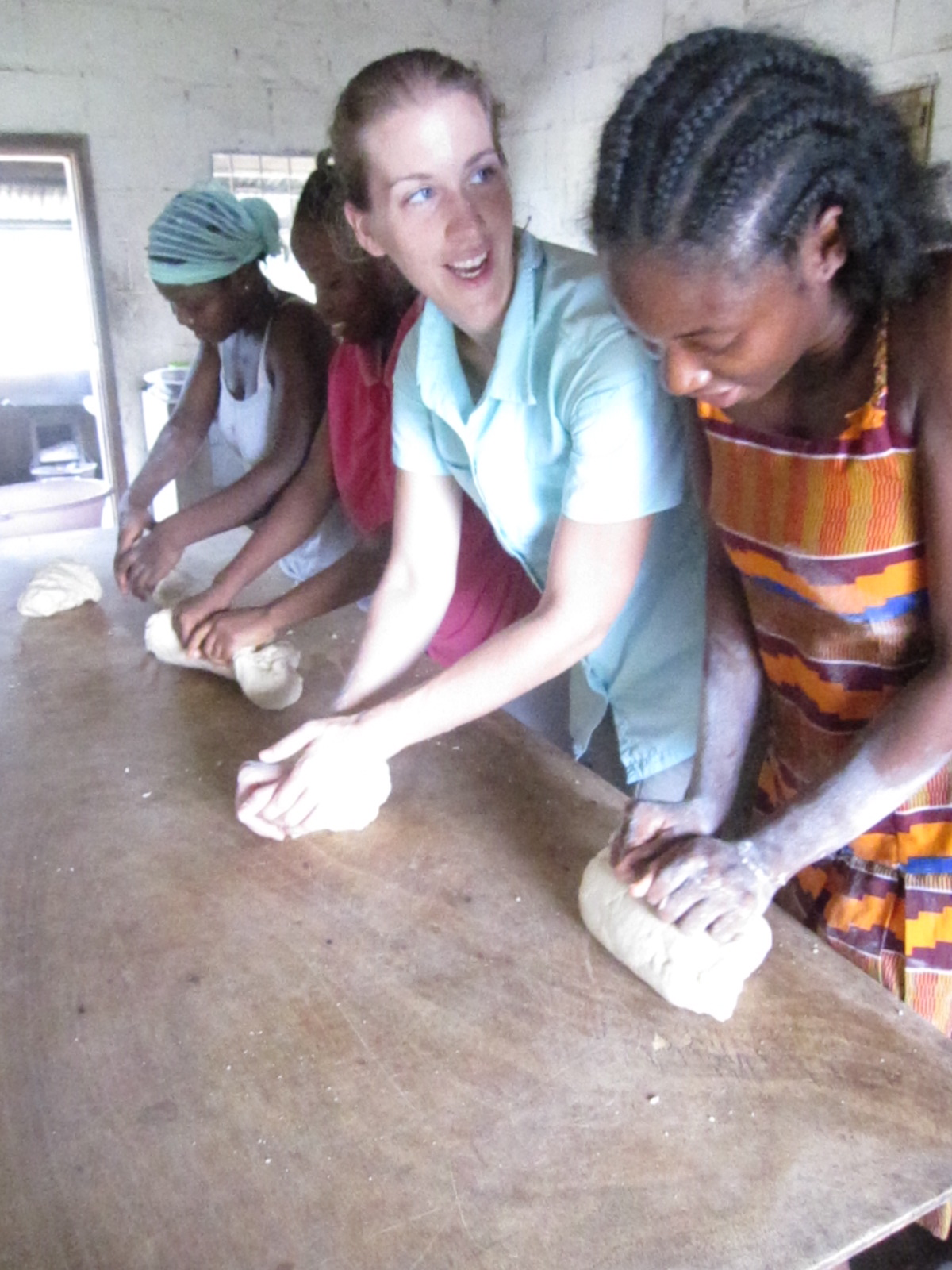 judy massah right and the older girls at the mission teach amy spelz to make african doughnuts WEBSITES BY JAYDEAN. Rosewood Therapies